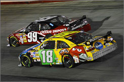 The cars of Kyle Busch (18) and Carl Edwards were too close for comfort last Saturday night at Bristol Motor Speedway.