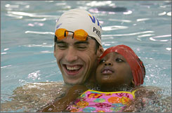 Michael Phelps finds a friend, part of the 14-time gold medalist's youth swimming initiative.