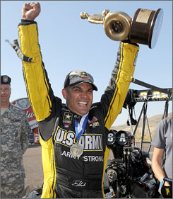 Tony Schumacher celebrates another victory at Old Bridge Township Raceway Park in Englishtown, N.J.