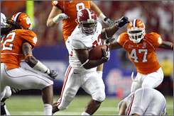 Alabama running back Mark Ingram, center, runs past multiple Clemson defenders during the first quarter at the Georgia Dome. Ingram rushed 17 times for 96 yards as Alabama upset Clemson 34-10.