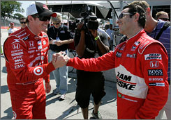Scott Dixon, left, enjoys some post-qualifying kudos from Helio Castroneves after taking the pole position at Detroit.