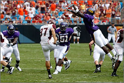 East Carolina's T.J. Lee makes the play of the game by blocking the punt of Virginia Tech's Brent Bowden.