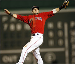 Boston Red Sox second baseman Dustin Pedroia makes a leaping catch on a line drive hit by the Chicago White Sox's Joe Crede during the seventh inning. Pedroia went 4-for-4 to lead Boston over Chicago 8-2.