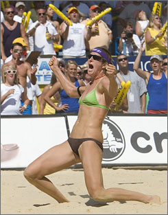Nicole Branaugh celebrates after she and her partner, Elaine Youngs, defeated two-time Olympic gold medalists Kerri Walsh and Misty May-Treanor at the AVP Cincinnati Open in Mason, Ohio, snapping May-Treanor's and Walsh's winning streak of 112 consecutive victories.