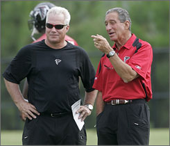 Mike Smith, left, is the Falcons' sixth head coach since Arthur Blank bought the team in 2002.