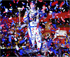 Jimmie Johnson enjoys a confetti shower in his home state after recording his third Sprint Cup victory of the season.