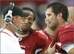 Cardinals coach Ken Whisenhunt, left, says Matt Leinart's future with the team is secure despite selecting Kurt Warner as the starter.
