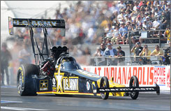 Tony Schumacher, who didn't qualify for the 54th NHRA Mac Tools U.S. Nationals until Sunday, ended up winning. His victory tied the all-time Top Fuel mark of 52 national event wins.