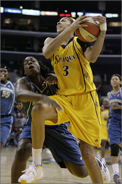 The Los Angeles Sparks' Candace Parker (3) goes up for a lay-up as the Minnesota Lynx's Nicky Anosike tries to defend in the second half of their game in Los Angeles. The Sparks routed the Lynx 82-58.