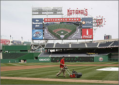 Nationals Park, being tended to by assistant groundskeeper John Royse, got off to an exciting start on opening night, but that's a distant memory as the Nationals strive to avoid losing 100 games this season. Still, attendance is strong.