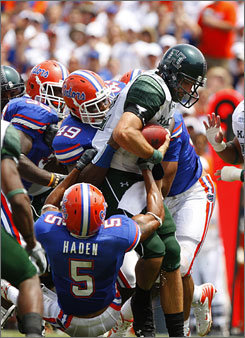Florida defensive end Jermaine Cunningham (49) and teammate Joe Haden sack Hawaii quarterback Greg Alexander in the Gators' 56-10 win last weekend in Gainesville.