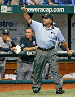 Umpire crew chief Charlie Reliford signals that a hit by New York Yankees' Alex Rodriguez off Tampa Bay Rays' Troy Percival is a home run, after an instant-replay review during the ninth inning. Rodriguez hit a two-run shot, and the Yankees beat the Rays 8-4.