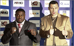 Vitali Klitschko, right, decided to end his retirement and fight Samuel Peter, despite his family's concerns.