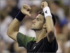 Novak Djokovic celebrates his victory over Andy Roddick after their quarterfinal match at the U.S. Open in New York. Next up for Djokovic is Roger Federer, who advanced to his 18th consecutive Grand Slam semifinal after topping Gilles Muller.