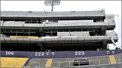 Hurricane Gustav damaged the west side of Tiger Stadium on the LSU campus in Baton Rouge. LSU postponed its football game against Troy after Gustav damaged the stadium and battered Louisiana's capital city worse than anticipated.