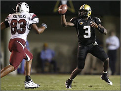 Vanderbilt quarterback Chris Nickson, trying to evade South Carolina's Cliff Matthews, helped lead the Commodores to their second straight victory over a Steve Spurrier-coached team.