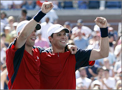 Mike, left, and Bob Bryan celebrate after they won the men's doubles title with a straight-set victory over Lukas Dlouhy and Leander Paes on Friday.