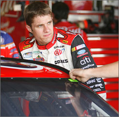 David Ragan hops in his car before practice at Richmond International Raceway. At the end of the session, he had posted a best lap of 121.529 mph, second only to Jeff Gordon on the speed charts.