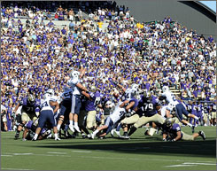 Brigham Young kept their BCS hopes alive by blocking an extra-point attempt by Washington kicker Ryan Perkins.