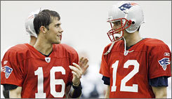 Matt Cassel talked football with fellow Patriots quarterback Tom Brady, right, during training camp in July.