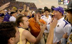 Fans took to the field immediately after East Carolina's victory over West Virginia. Some fans congratulated head coach Skip Holtz, some had confrontations with police.