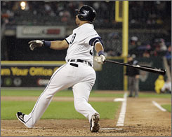 The Detroit Tigers' Gary Sheffield hits a grand slam against the Oakland Athletics in the second inning in Detroit. Sheffield later hit another homer, the 250,000th in major league history. The Tigers beat the A's 14-8.