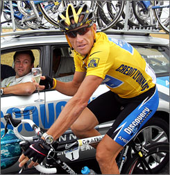 Lance Armstrong toasts with champagne as he winds down his victory in the 2005 Tour de France. Rumors have spread that the retired Texan plans to ride again.