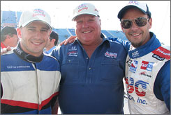 Team owner A.J. Foyt takes center stage on pit road with his driver lineup at Chicagoland: Veteran Darren Manning, right, and rookie Franck Perera.