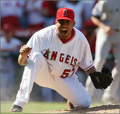 Angels closer Francisco Rodriguez strikes a familiar pose this season after nailing down a 4-2 win over the New York Yankees on Wednesday. The save was Rodriguez's 56th of the season, putting him one away from tying Bobby Thigpen's major league record.