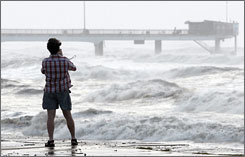 Hurricane Ike begins to make its presence felt on the Texas coast as a Galveston resident watches.