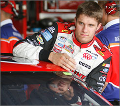 David Ragan will switch from the red, white and blue of AAA to the brown and yellow of UPS next season.