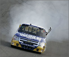Ron Hornaday smokes his tires after soaring to his fifth victory of the season on NASCAR's truck tour.