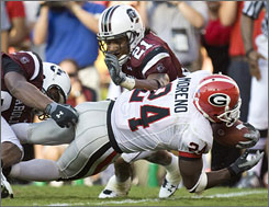 Knowshon Moreno scored the go-ahead touchdown, and No. 2 Georgia held off South Carolina to win 14-7.