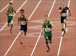 Oscar Pistorius sets the pace down the stretch in the 200-meter final at the Paralympic Games.