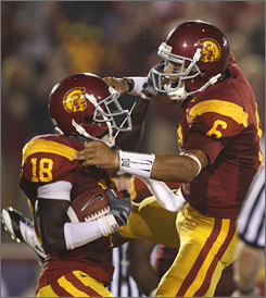 USC quarterback Mark Sanchez, right, celebrates with teammate Damian Williams after the two connected for a third-quarter touchdown pass in the Trojans' victory over the Buckeyes.