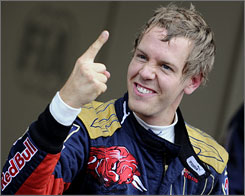 Sebastian Vettel soaks in the moment after putting Scuderia Toro Rosso on pole position at Monza.