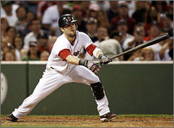 Dustin Pedroia may not be 6-feet tall but his big bat this season has made up for his stature as he leads the American League in hitting with a .327 batting average.
