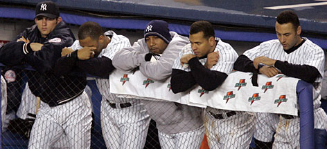 The 2004 Yankees players watch the final moments of their Game 6 loss to the Red Sox in the 2004 American League Championship Series in New York. The Bronx Bombers became the first baseball team to blow a 3-0 series lead as Boston won Game 7 10-3.
