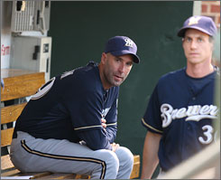 Milwaukee interim manager Dale Sveum, left, hopes veteran Craig Counsell, with his playoff experience, will help instill a sense of urgency in his Brewers' teammates.