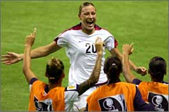 Abby Wambach credits her time with the WUSA's Washington Freedom with helping her to the national team.