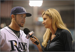 ESPN's Erin Andrews, here with Evan Longoria, is one of many female sideline  reporters, while Pam Ward is the only woman regularly doing football play-by-play.
