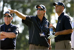 Captain Paul Azinger, center, and Stewart Cink, right, of the U.S. team prepare for the 2008 Ryder Cup.