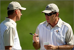 Robert Karlsson and captain Nick Faldo of the European team look over notes prior to the 2008 Ryder Cup.