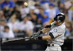 The Seattle Mariners' Ichiro Suziki tied the major league record of eight consecutive 200-hit seasons when he beat out an infield hit in the eighth inning against the Kansas City Royals.