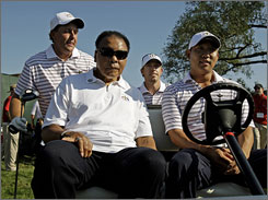 Phil Mickelson, left, gets into a golf cart with Muhammad Ali and teammates Hunter Mahan, back right, and Anthony Kim, front right. Mahan and Kim are Ryder Cup rookies.