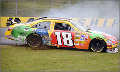 Kyle Busch's car spins while racing in New Hampshire last weekend. The Chase contender was one of a trio of drivers who traveled to Atlanta this week to test new Goodyear tires, causing some controversy among the other drivers.