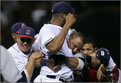 Cleveland Indians pitcher Fausto Carmona, center, punches Detroit Tigers' Gary Sheffield during a benches clearing brawl in the seventh inning in Cleveland. Both players were ejected, and the Indians beat the Tigers 6-5.