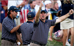 Boo Weekley of the United States celebrates alongside his captain Paul Azinger, left, on the 17th hole after Weekley and J.B. Holmes won their match in the afternoon.