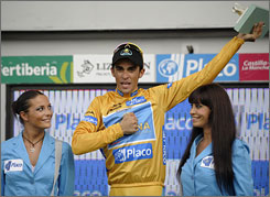 Alberto Contador celebrates atop the podium after the 21st stage of the Spanish Vuelta.