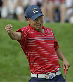 Team USA's Anthony Kim exults on the 14th green after clinching his 5-and-4 victory over Sergio Garcia in Sunday's first match.